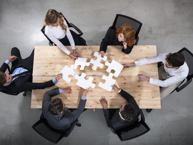Concept of integration and startup with puzzle pieces
